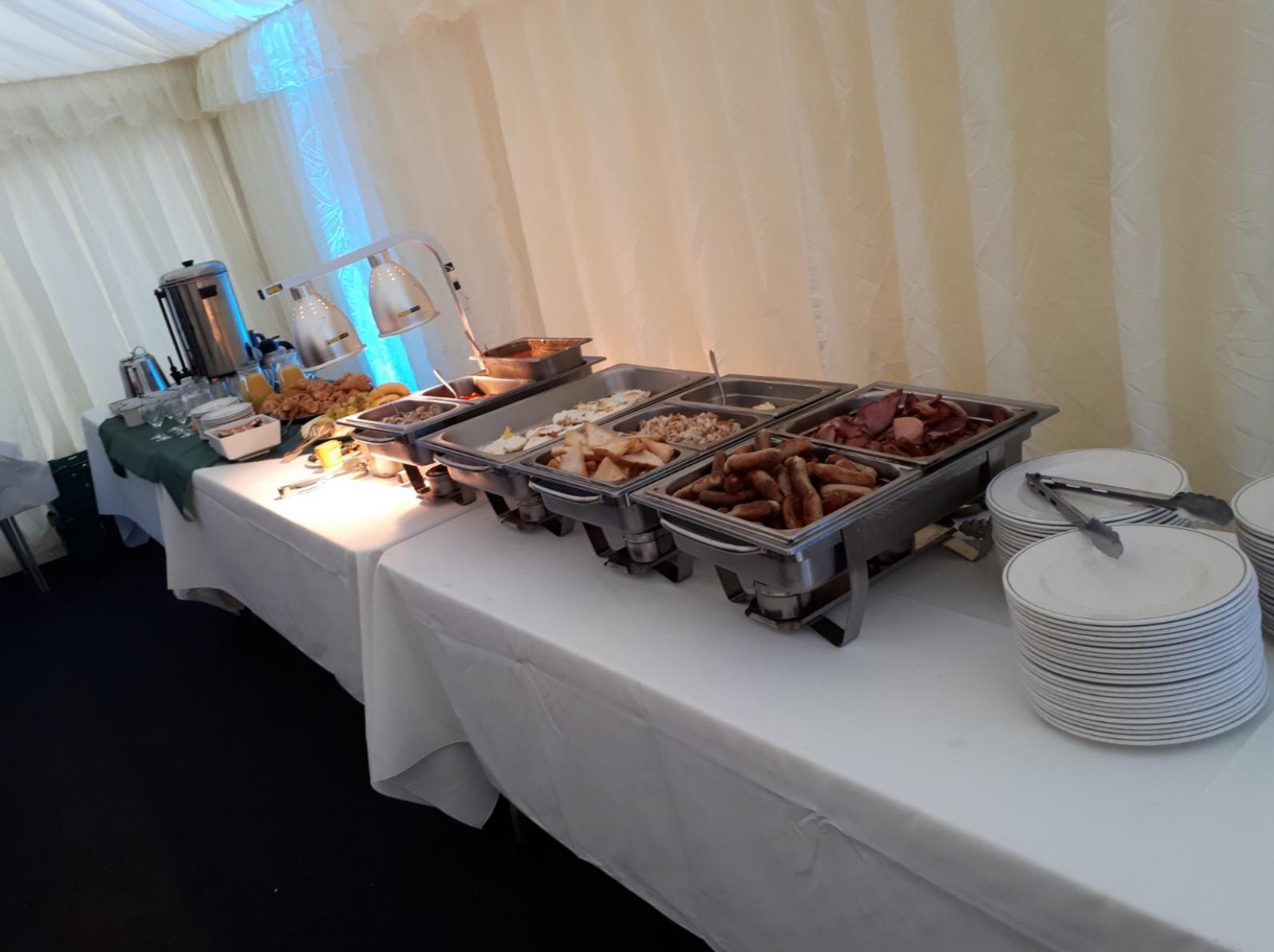 Full English breakfast buffet style serving.