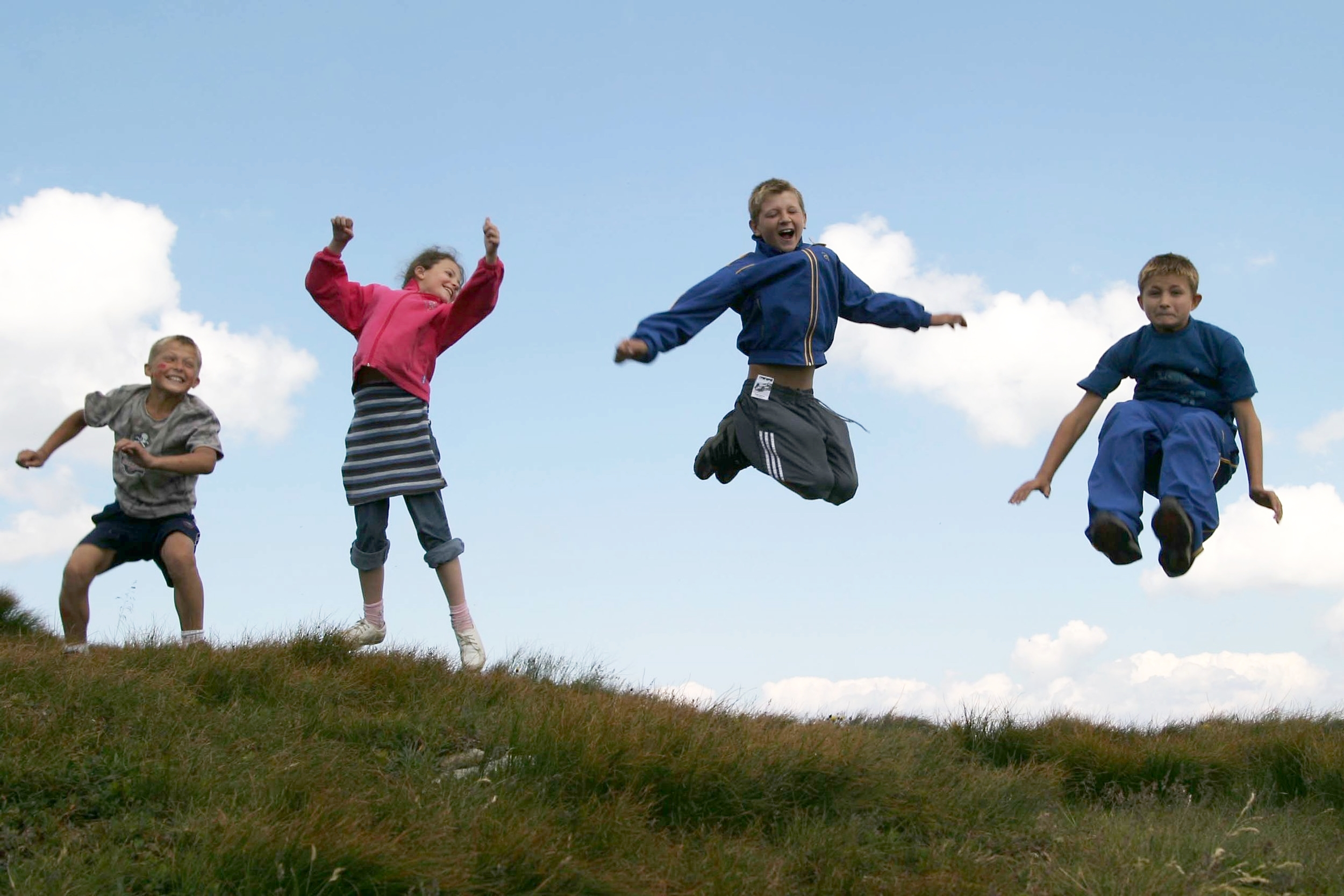 Help Us Help The Children - Wide 1 - Kids Jumping (IS).JPG