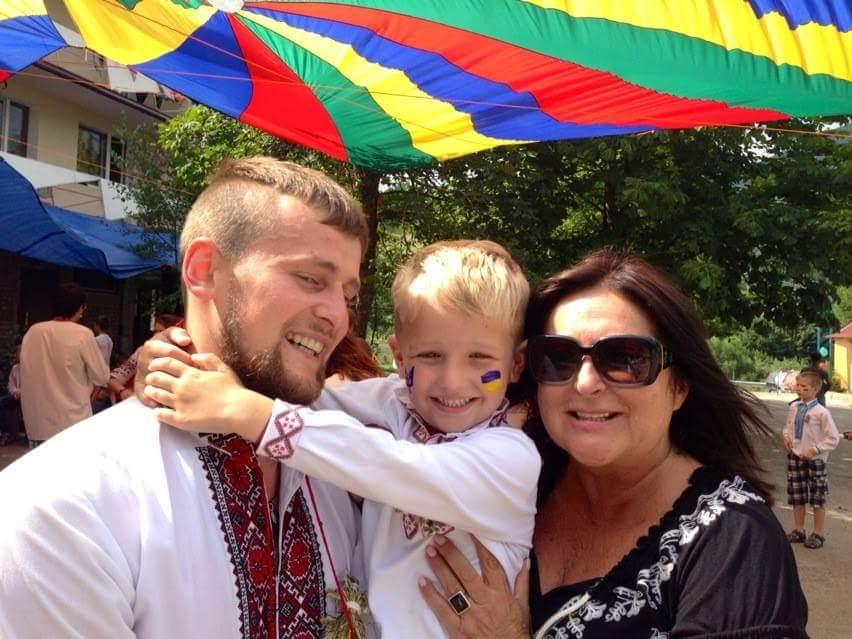 HUHTC - Project Pic - Lasha, Serhiy, and Kid (Lasha).jpg