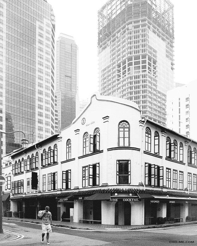 Quiet Sunday - Taken on Aug 24, 2014 - SingaporeThe usual hustle and bustle of this business district turned impossibly quiet and laid back on weekends, once a while you'll see a person walked by, or some tourists past by... no shops were open, no cars, I stood in the middle of the street and took this picture.