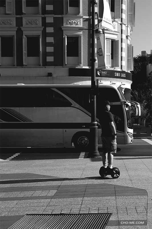 """A BRIEF MOMENT July 14, 2019 - Stamford Road - Light Gallery  An E-Rider, a Bus and a Building, this may appeared to be a regular street shot photo, but no, there's more to it, two seconds """"before"""" I pressed the shutter, there was no bus or e-rider in the view, can you believe? …more"""