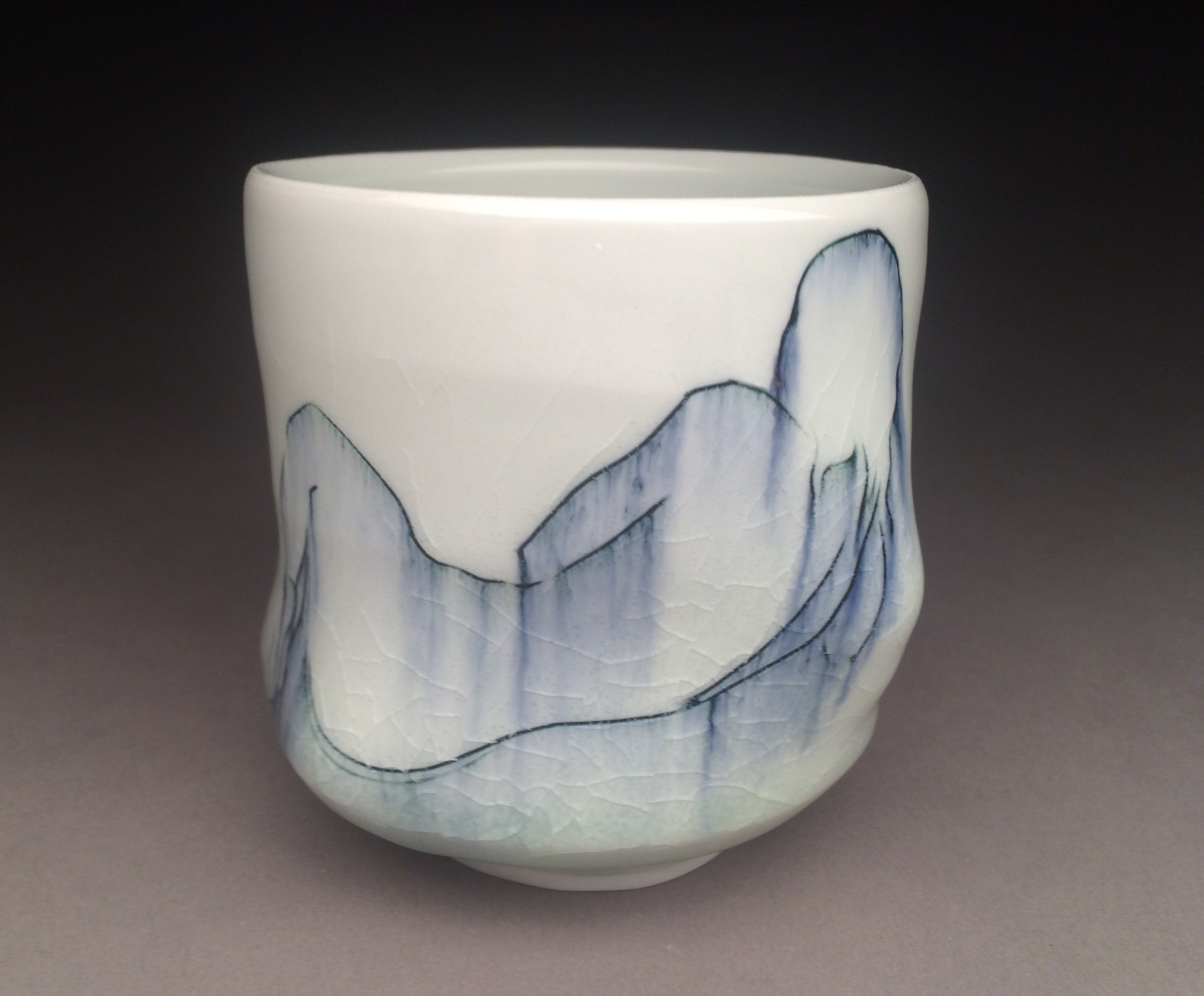 Amy Smith  Smith works intuitively in clay. Her open forms gently hold space. Fluid glazes break over carved surfaces. Her figurative cups are composites made up of two dimensional drawings.  Amy's website:  http://www.amysmithporcelain.com/