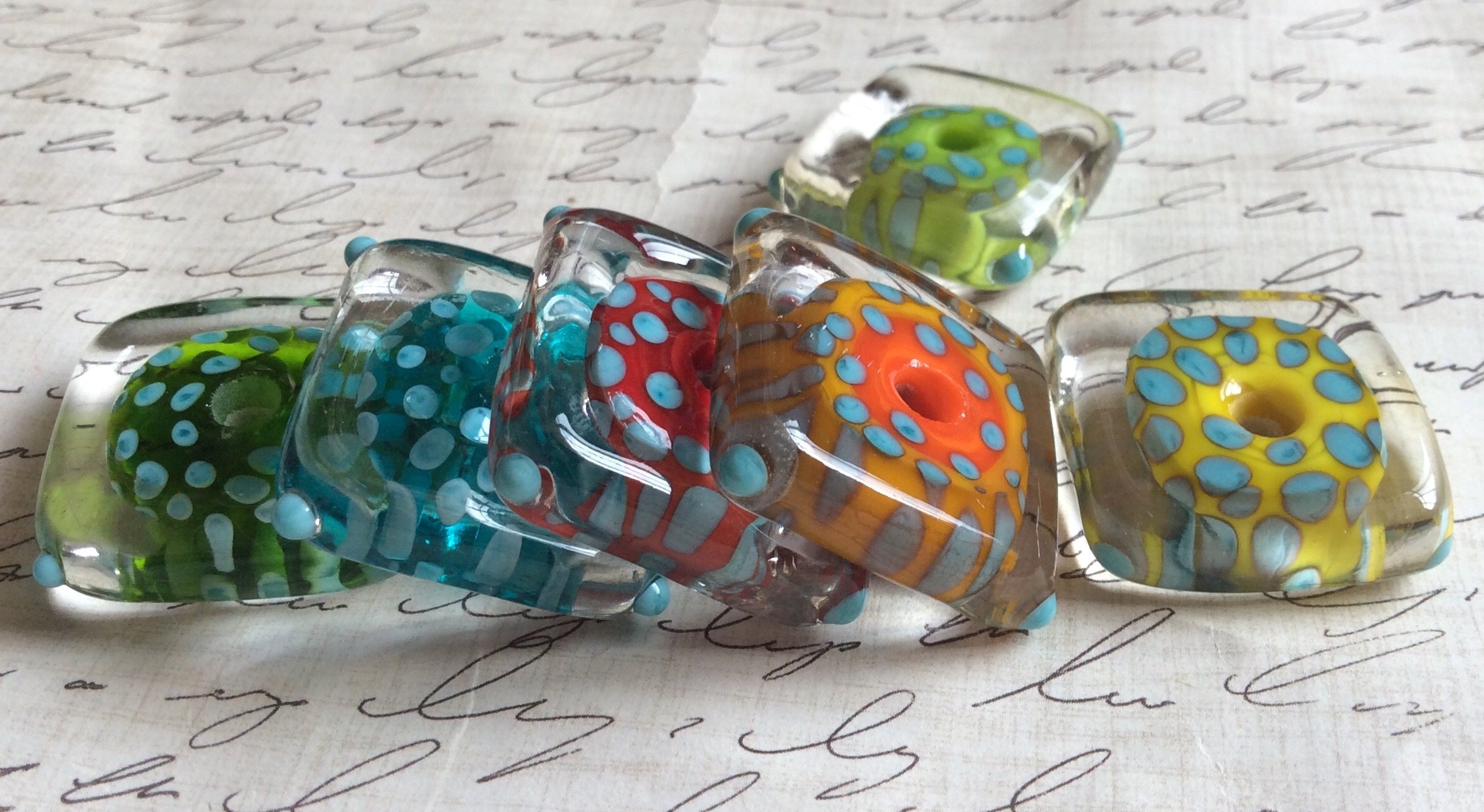 Jodie Marshall  Jodie makes colorful glass lampwork beads and wearable art.  Check out more creations on Jodie's blog:  http://marshalljodie.blogspot.com/