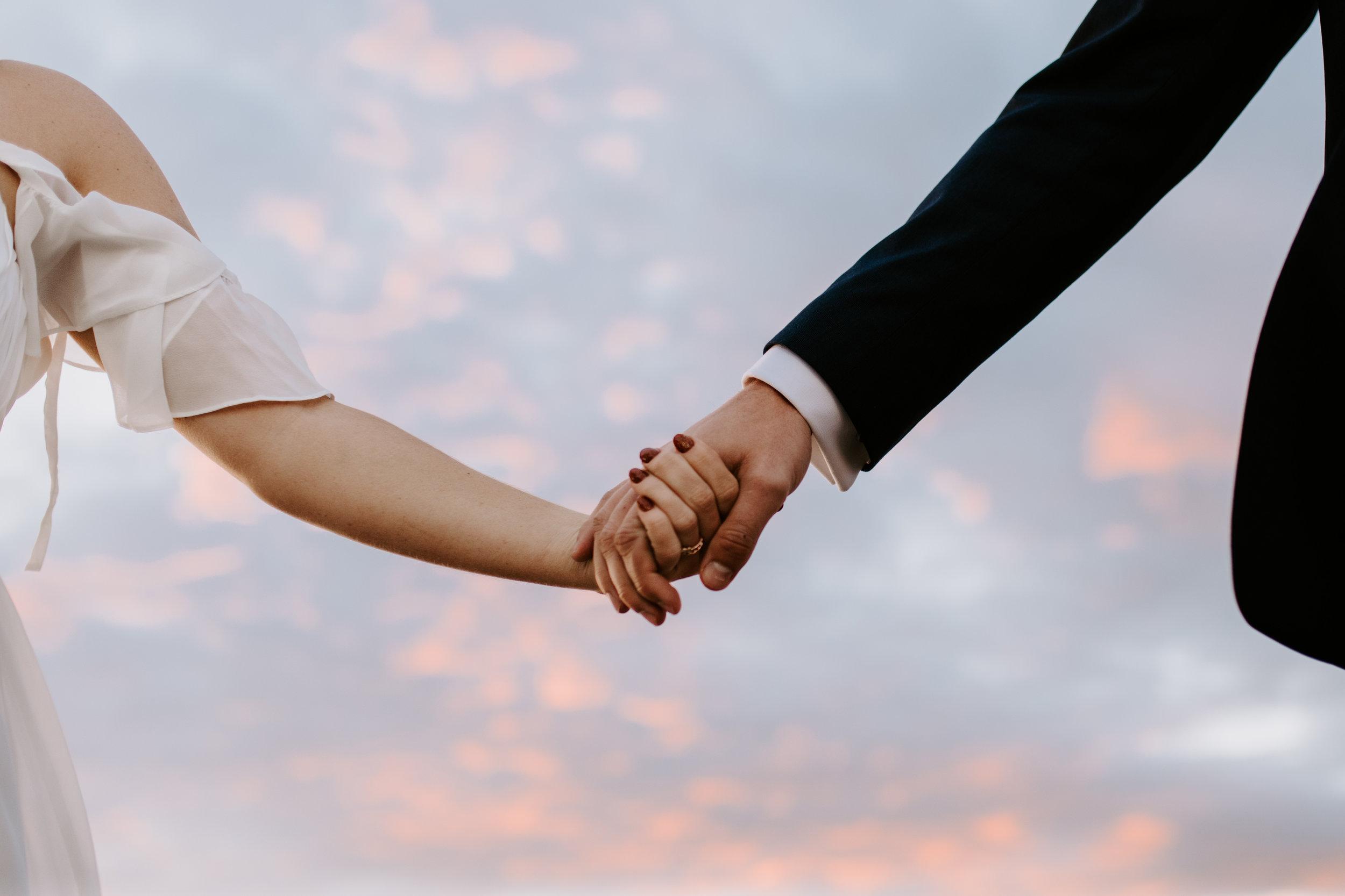 Pink Sky Holding Hands