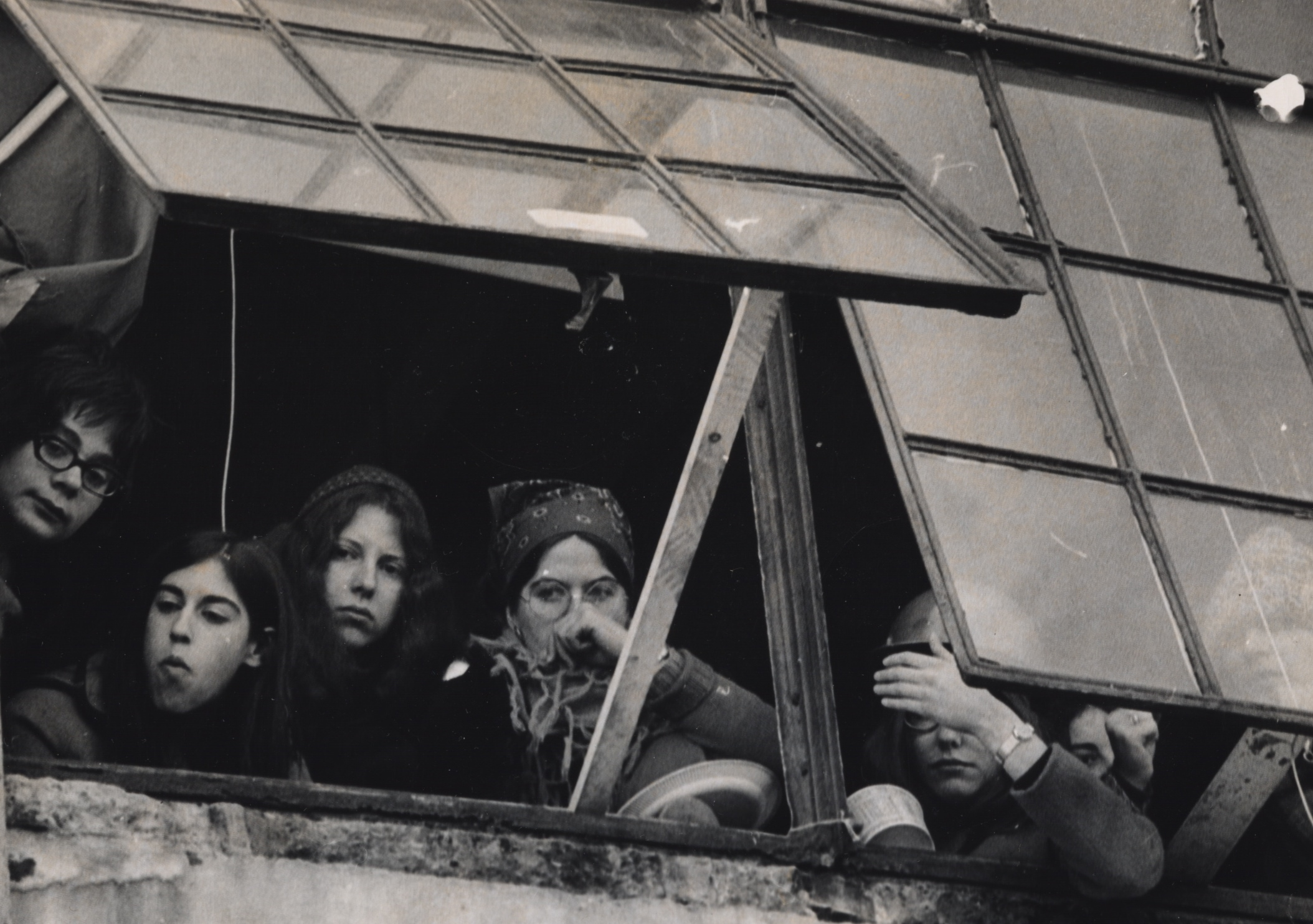 Left on Pearl-Women occupiers anxiously keep watch from window at 888 Memorial Drive.jpg