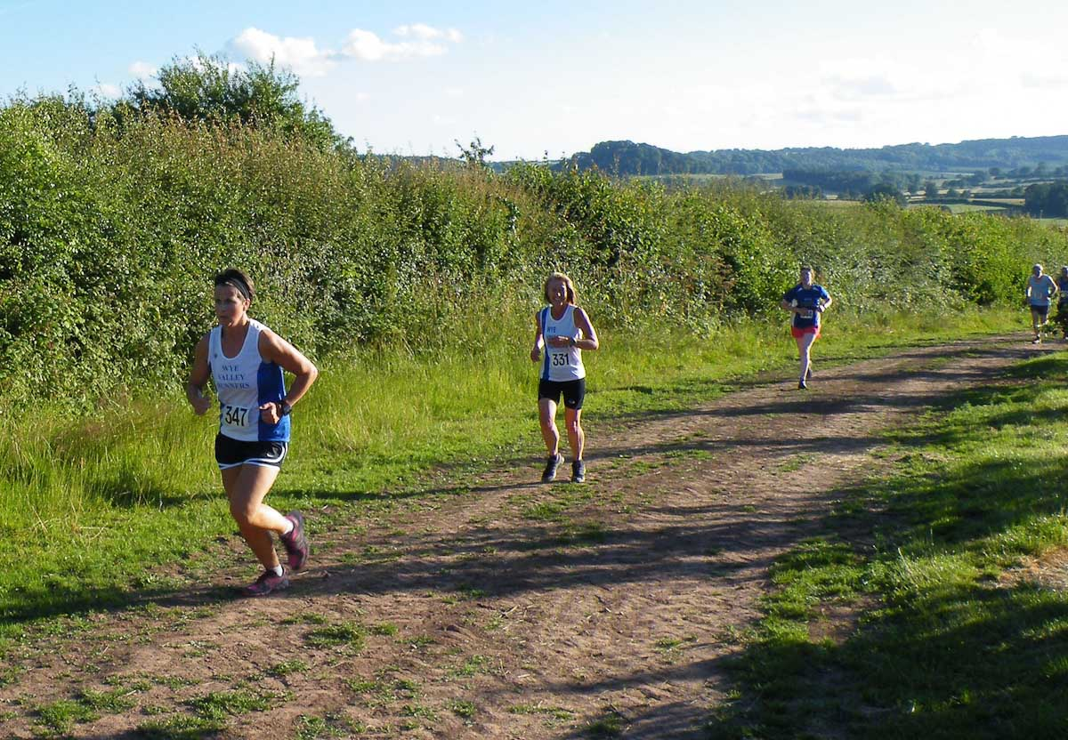 """ABBEYDORE WEDNESDAY 27th June 2018  Wye Valley Runners look forward to welcoming everyone back to Abbeydore.  The course is best described as """"not flat"""".  Race starts 7.30 prompt. Plenty of parking - with a short walk to start so please arrive in plenty of time.  Directions here : https://goo.gl/lBpsnI   Postcode for Sat Nav HR2 0JQ  A465 from Hereford to Abergavenny  Turn right opposite Wormbridge church, signposted Abbeydore  Continue and straight over crossroads to a T junction and then follow arrows from there"""