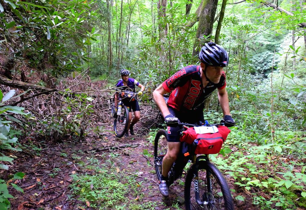 Riders push through debris and fallen trees near the start.