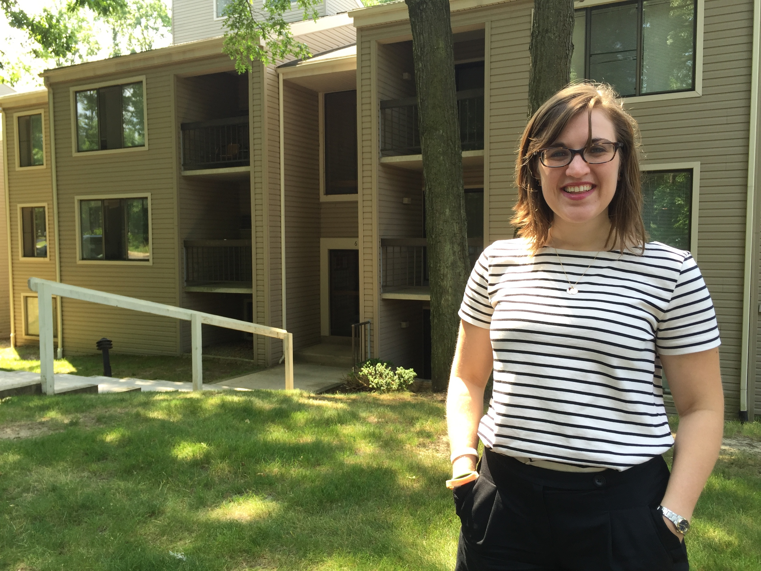 Hailley in front of her new apartment building