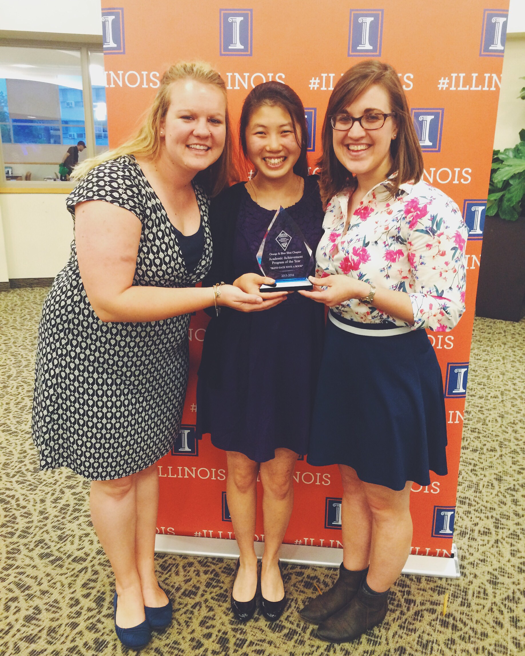The infamous award! From L to R: Caitlin, a good friend and Resident Director, and one of our RAs in FAR.