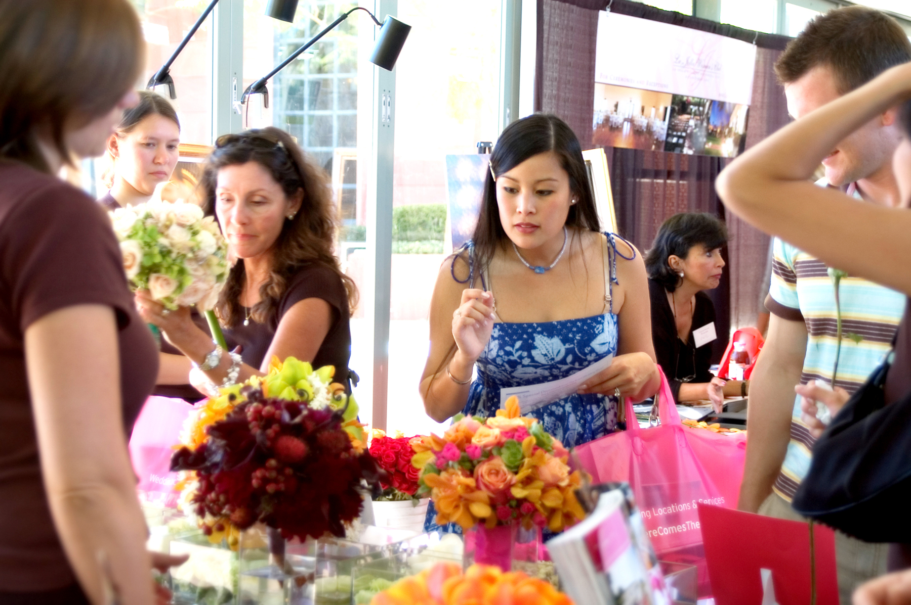 pretty Asian inquisitive bride with florals.jpg