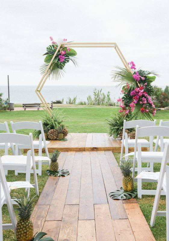 plat event rental arch hexagon wood aisle.jpg