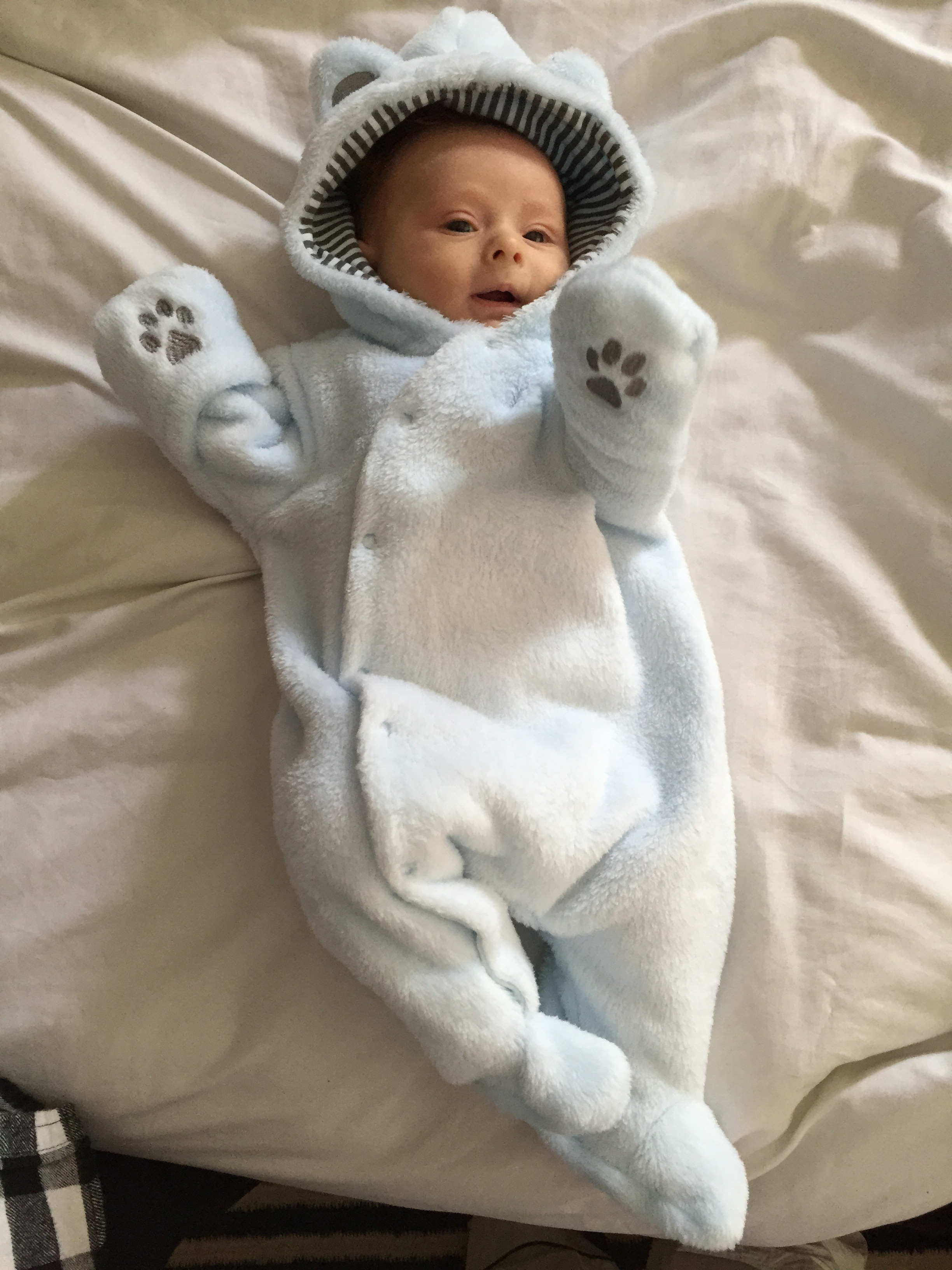 Showing off his new bear onsie