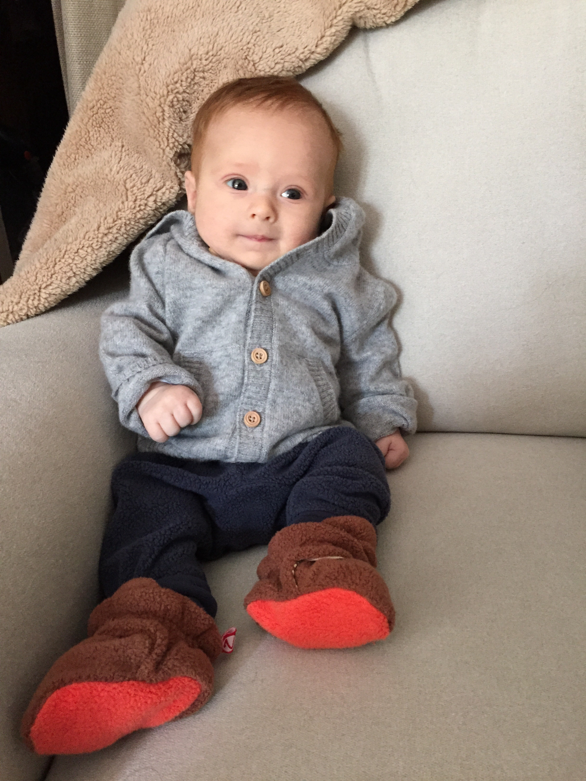 Nico approves of cashmere cardigans. Thanks Auntie Em!