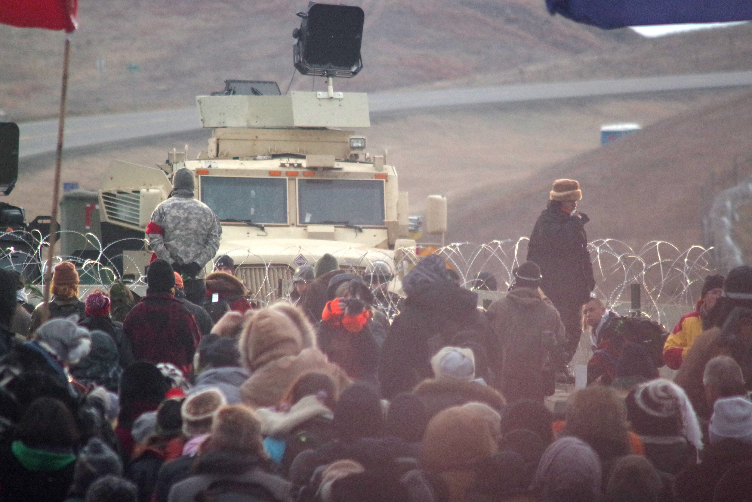 Front of women led action at the police barricade on the bridge at Standing Rock, November 27th.