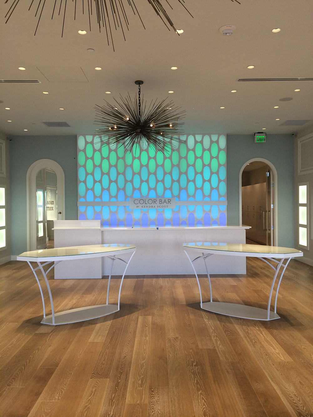 """Scope: Custom color-changing """"Color Bar"""" and steel fabricated glass-top tables"""