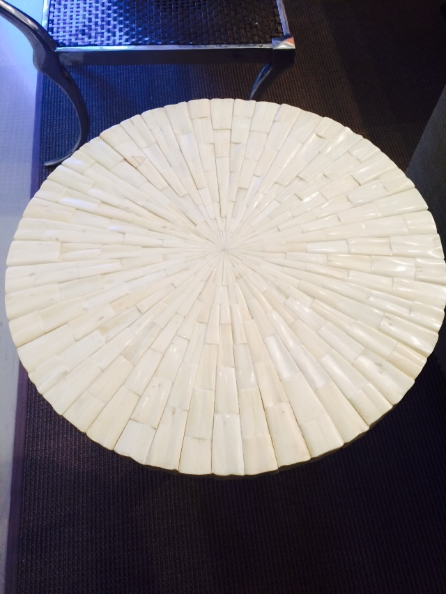 White pearlescent mosaic tile drink table in a radial pattern
