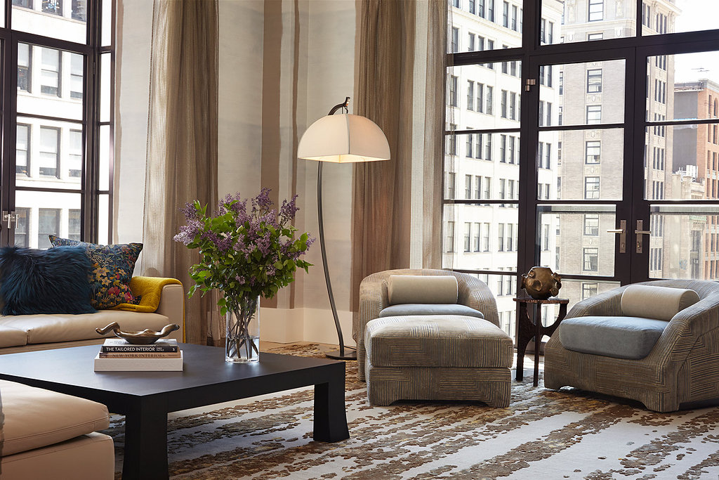 Soft tones in this comfy living room accentuate the view