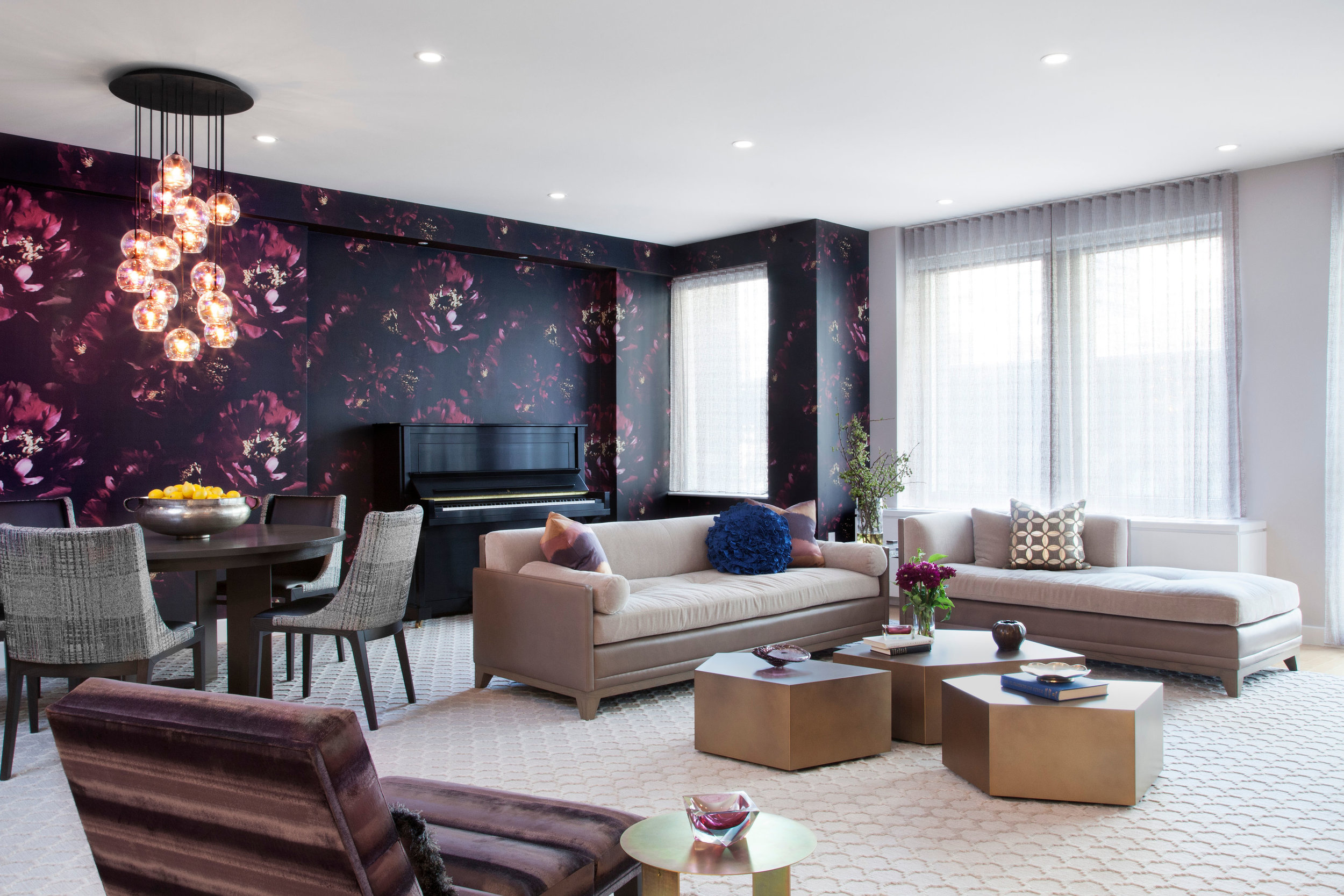 Everything in this living/dining area was designed with the clients in mind. From the bold floral wallpaper (which inspired the entire space) to soft mohair seating and inviting ombre stripes, color & geometric shapes abound.