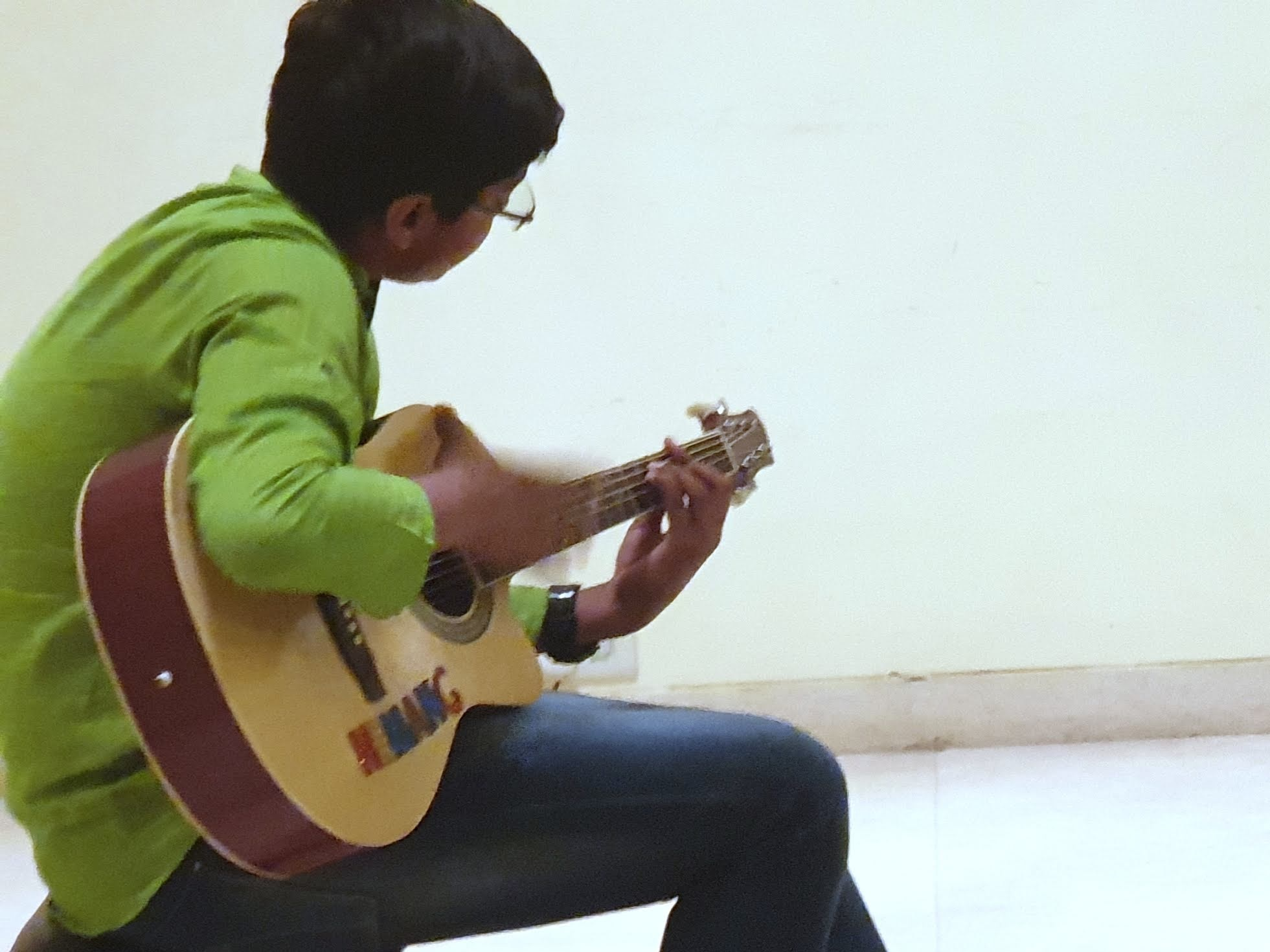 Flamenco guitar student from a pod in Faridabad.