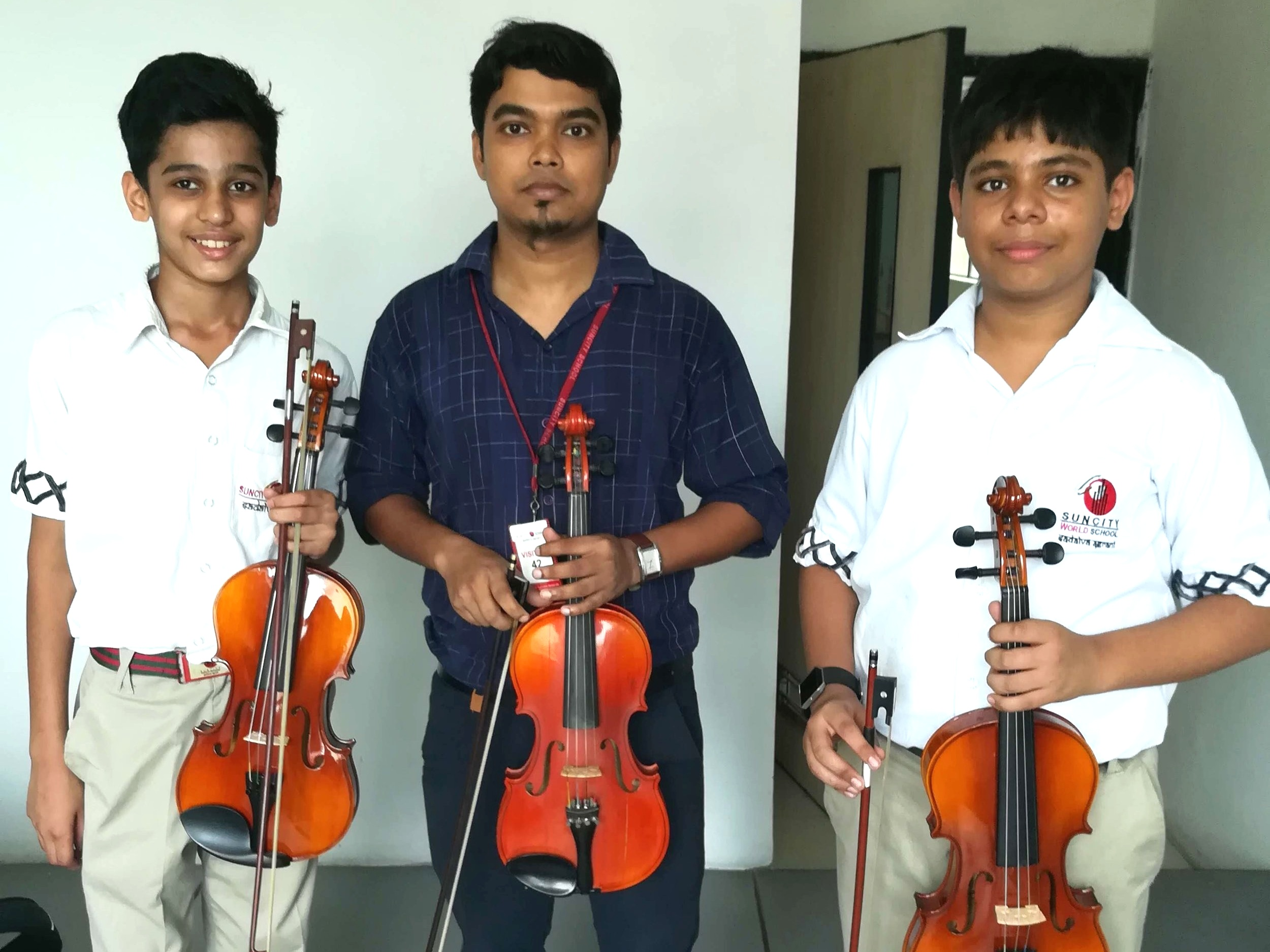 Violin students at Suncity School outreach site