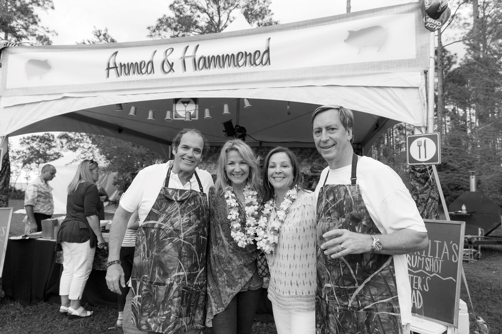 """Steve and Lynn Dugas with Valerie and Mike """"Chi Chi Miguel"""" Thompson at the 2016 Throwdown Benefit Auction and Barbecue. Photo by Steven Freeman."""