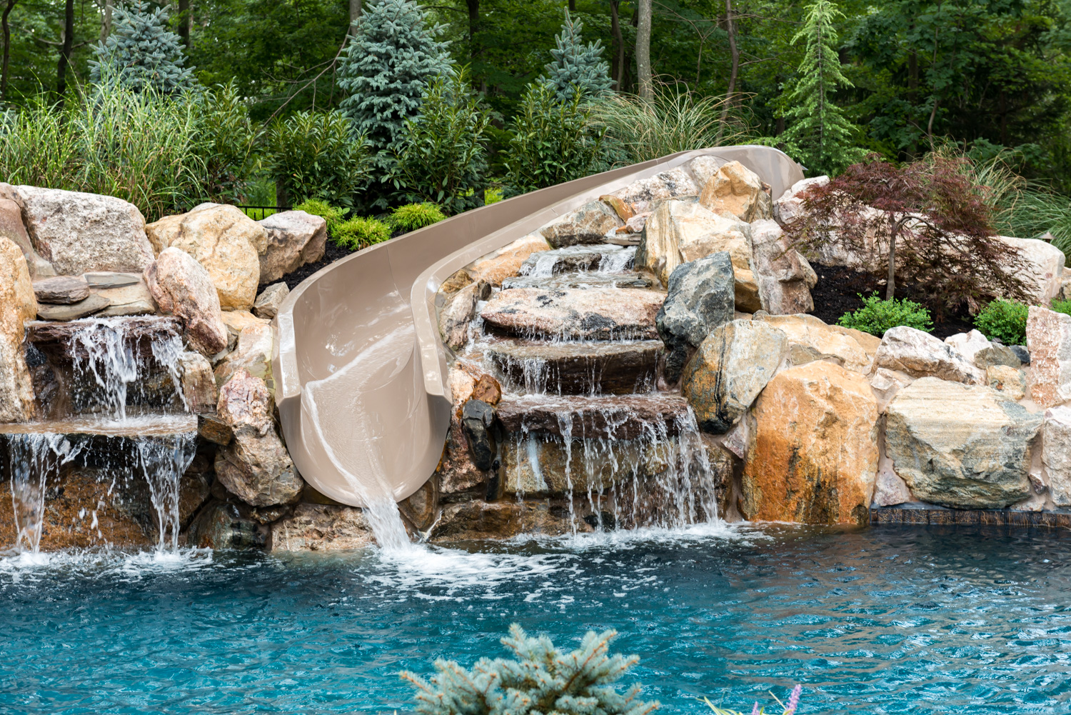Nj Custom Designed Swimming Pool Slides And Water Features For Residential Nj Properties K C Land Design Construction