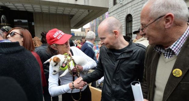 Paul Murphy greeting a supporter at a protest over the policing of the anti-water charges movement at the Central Bank in Dublin on Saturday. Photograph: Dara Mac Dónaill / The Irish Times