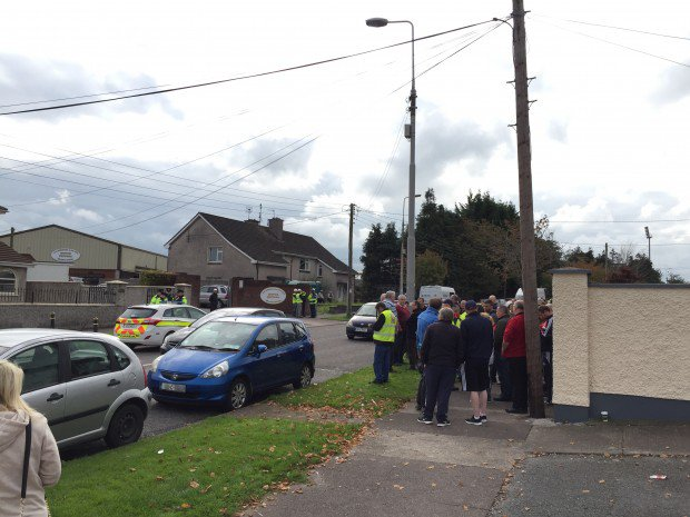 Gardaí look on as anti water meter protesters prevent the installation of meters on Pearse Road, Ballyphehane this week.