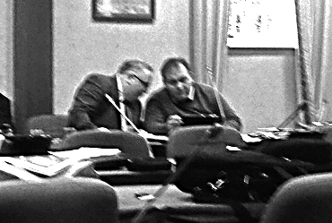 (l to r) Let's decide on a plan of action. Councillors Frank McBrearty and Michael McBride confer discreetly at Monday morning's meeting of Donegal County council.