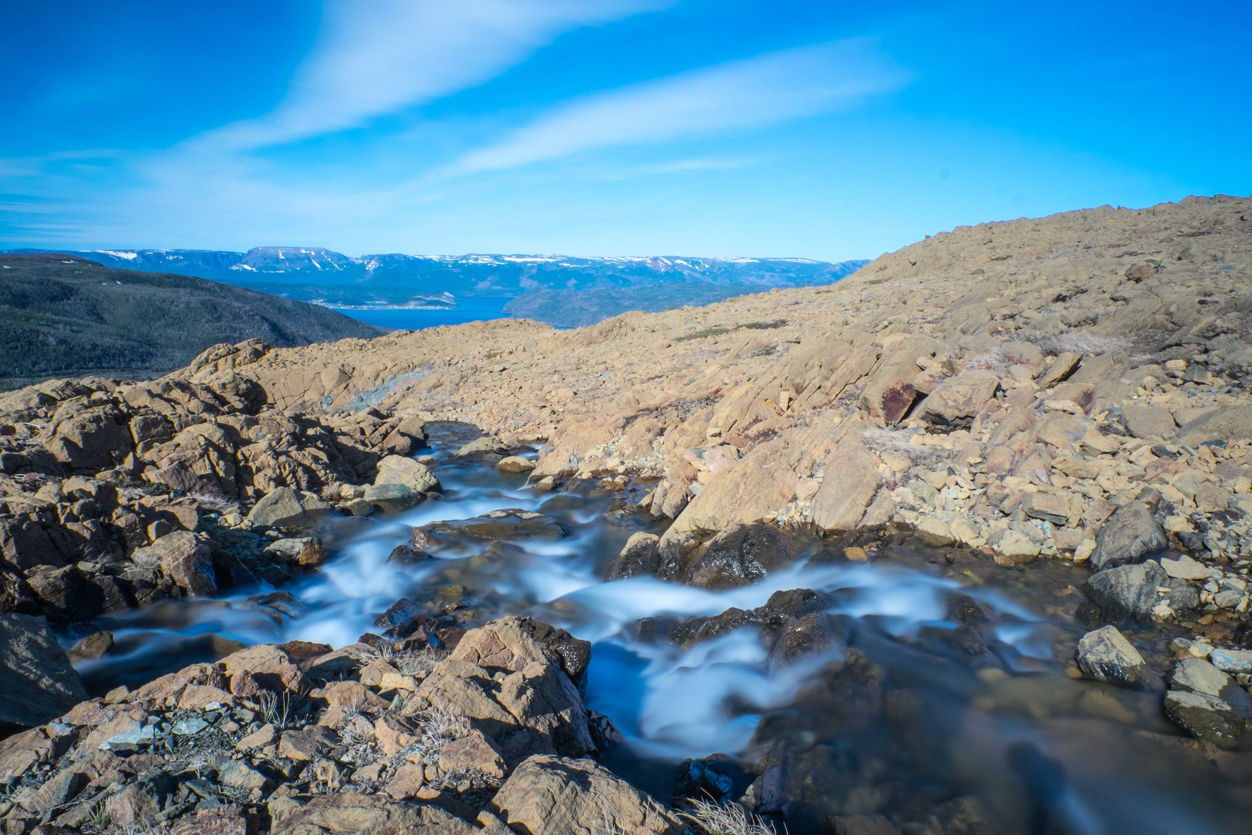 Snow melts on top of Tablelands in Gros Morne National Park.