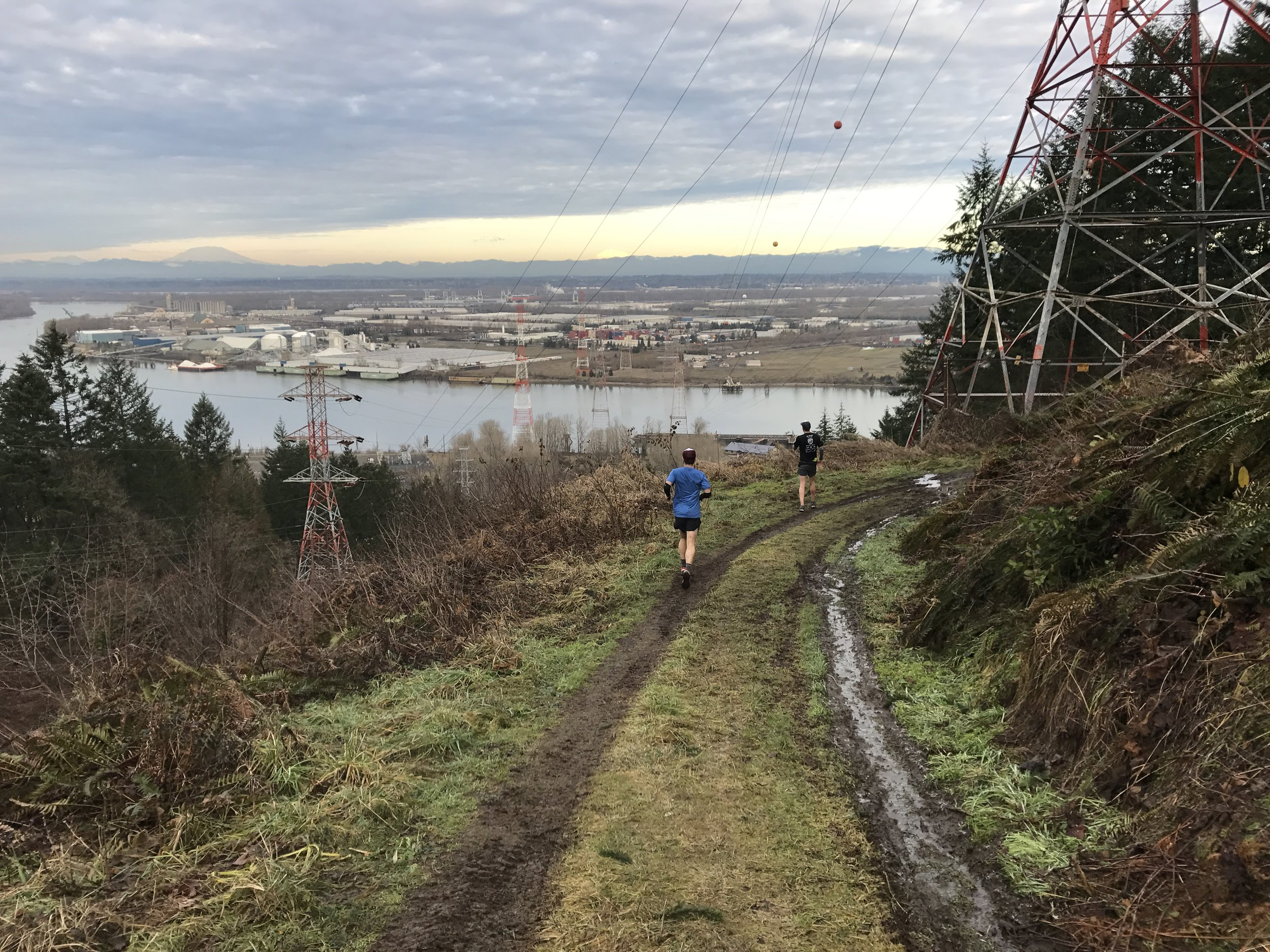 Jordan and Brian take in the views of Mt. St. Helens and Mt. Adams from a muddy BPA Road - North Portland
