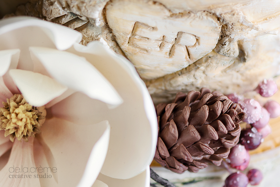 """Hidden amongst the floral cluster, the couple's initial could be seen carved into the """"tree"""""""