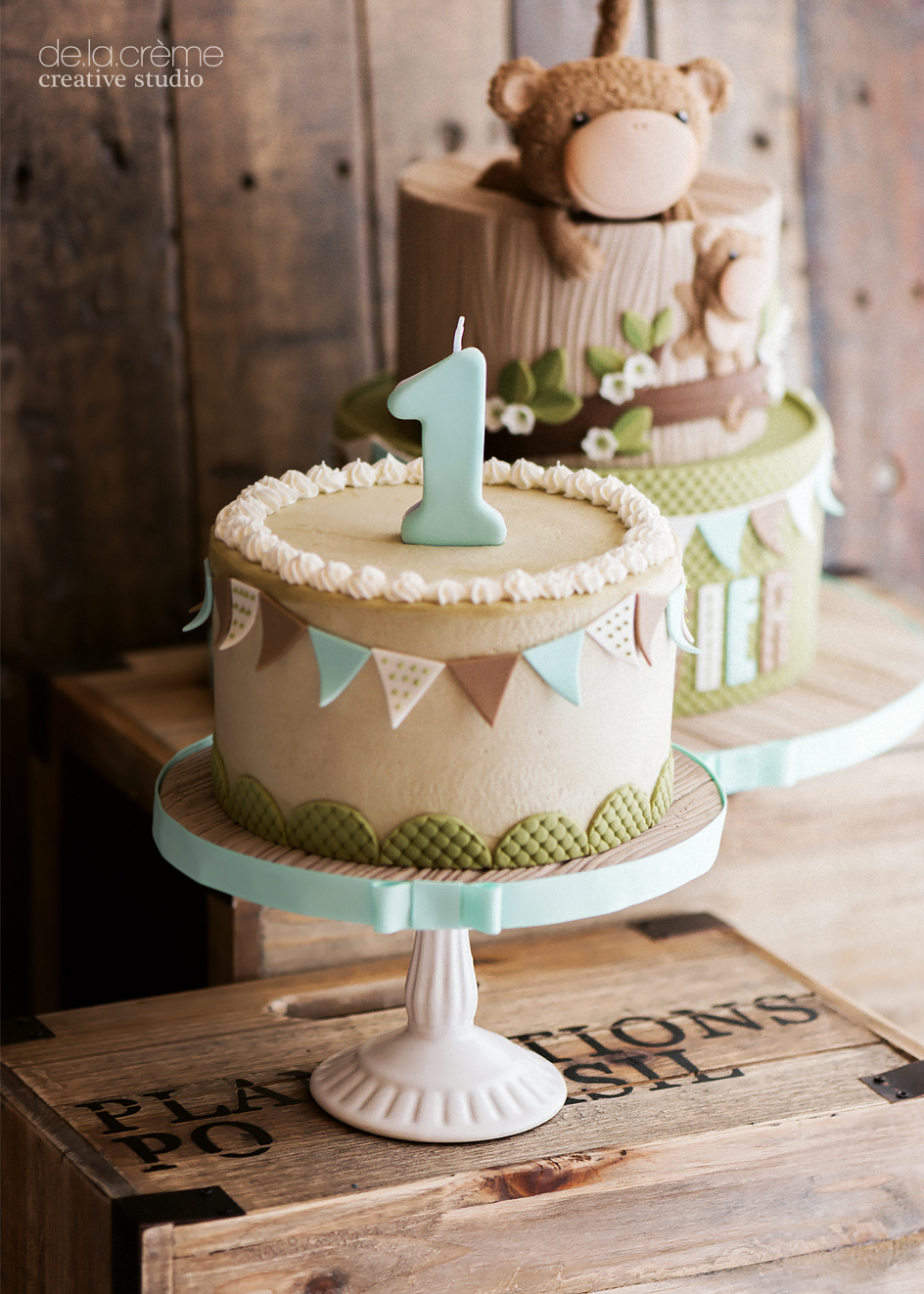 Xavier's mini cake was smashed open to reveal baby blue, french vanilla buttercream—yay, you're getting a little brother!