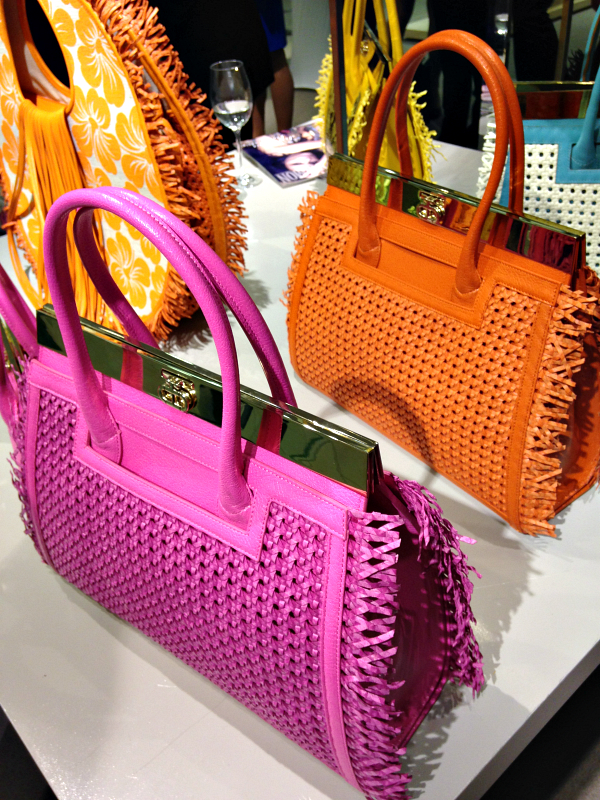 """Cheery """"Roma Totes""""at the BCRF benefit at Saks Boston from the Spring/Summer 2015 collection."""