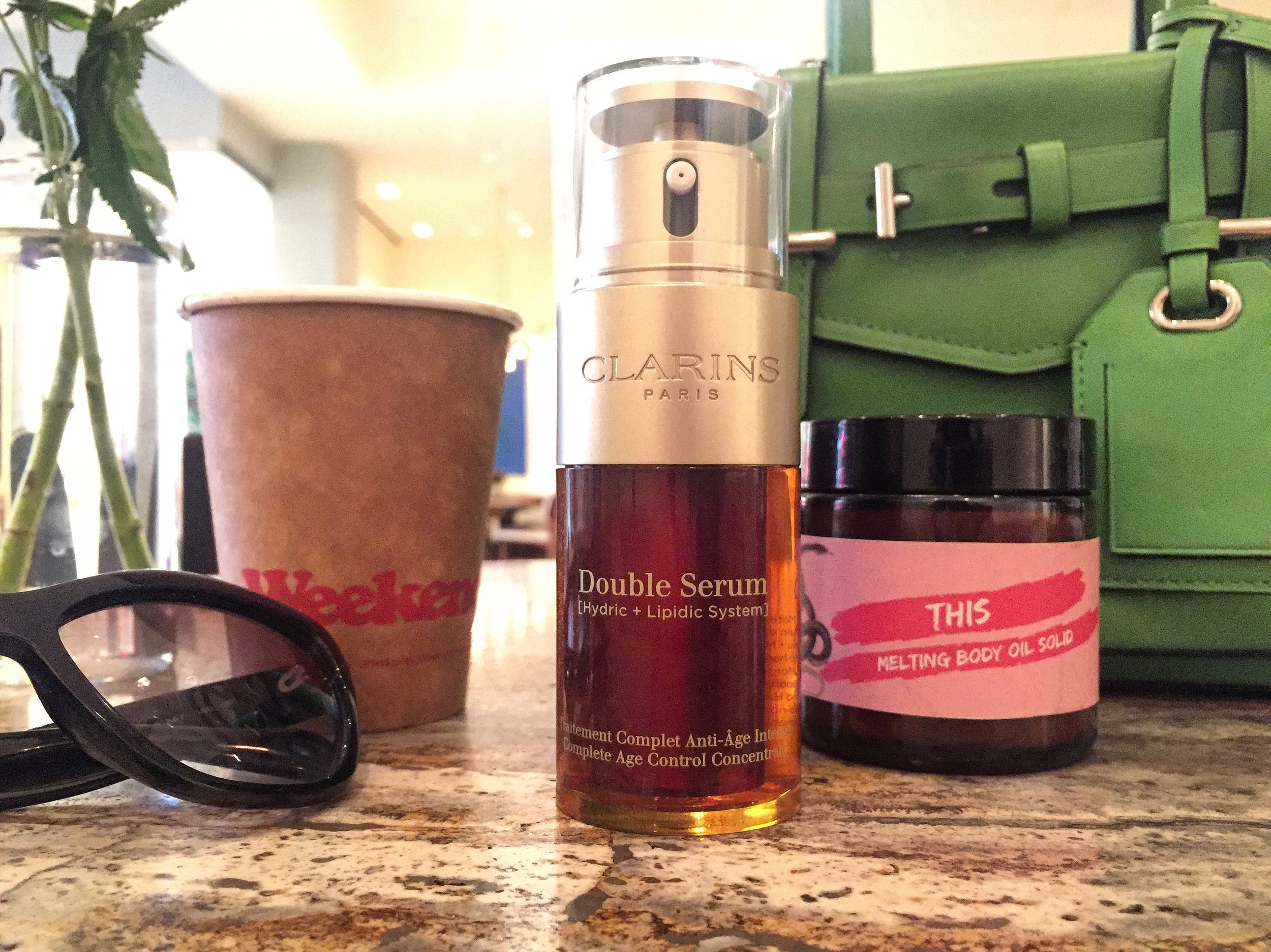At  The Joule Hotel in Dallas , Texas enjoying a cappuccino and my moisturizing army,  Clarins Double Serum  and  This Melting Body Oil .