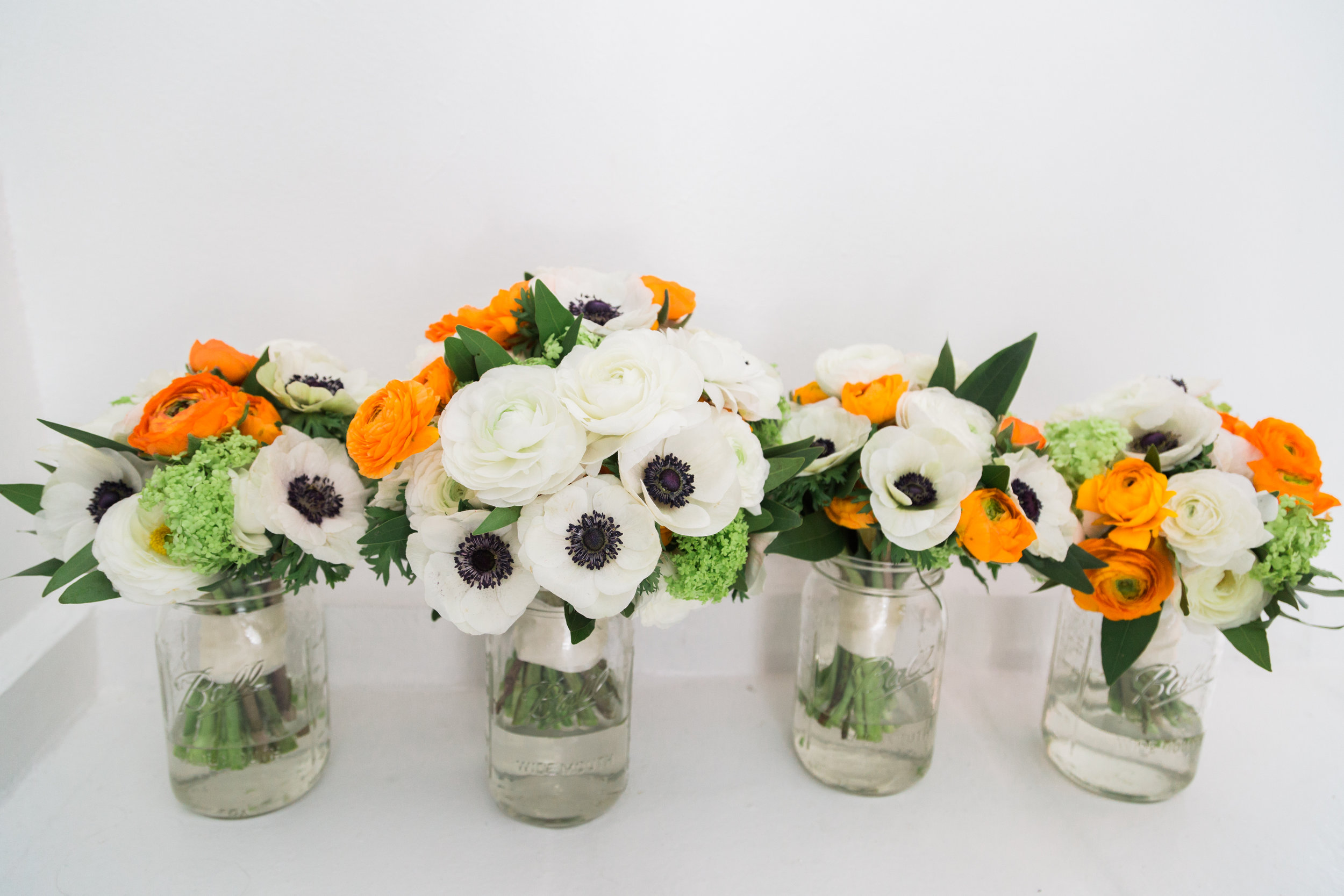 Orange and white bouquets.jpg