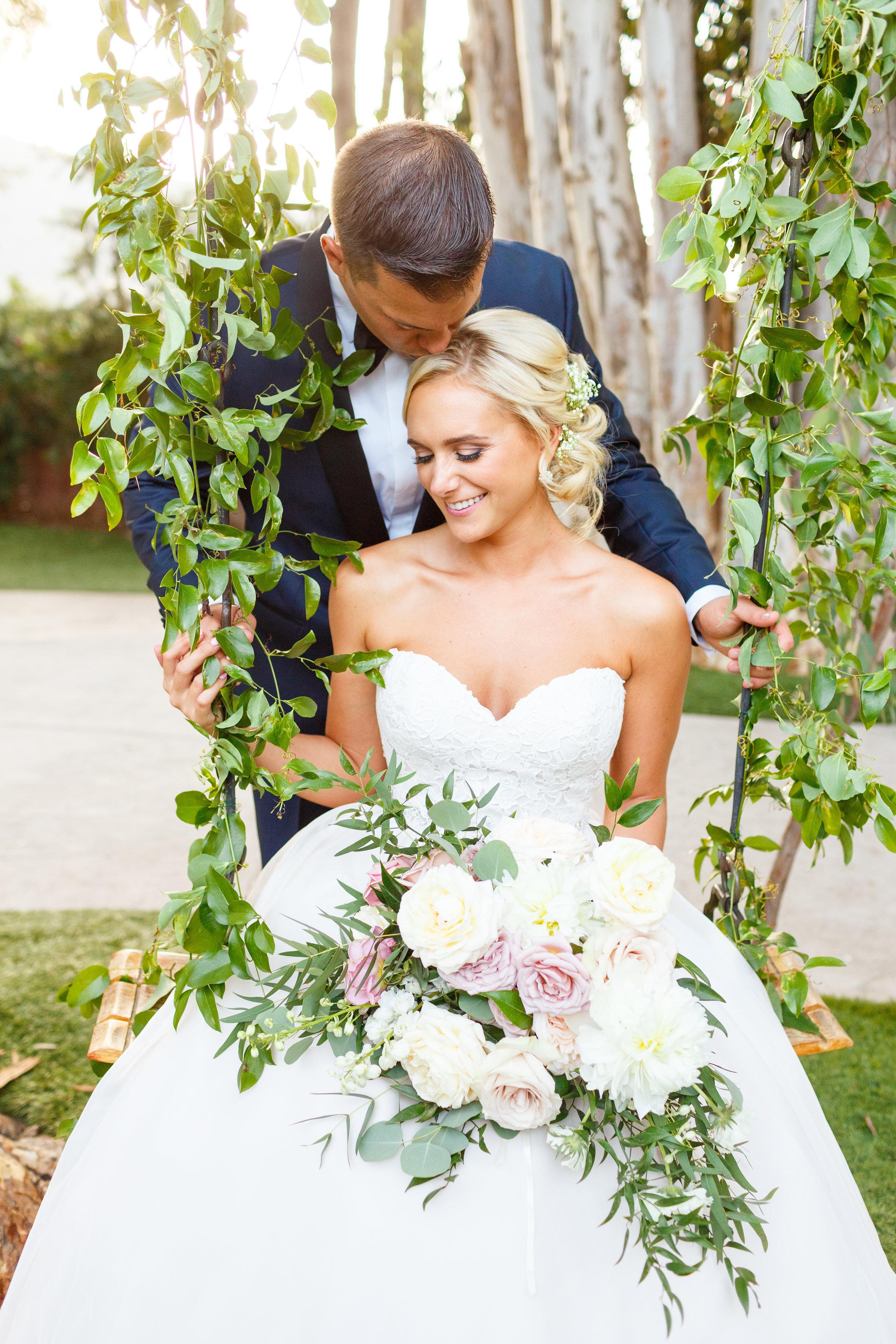 Wedding swing flowers.jpg