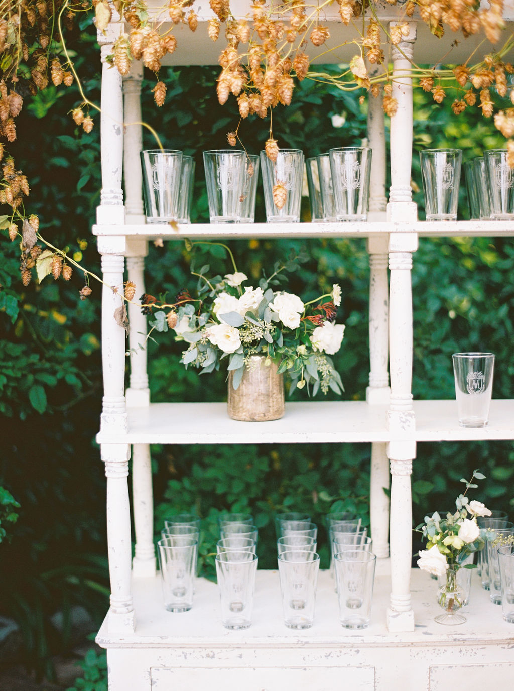 cocktail hour bar shelf flowers.JPG