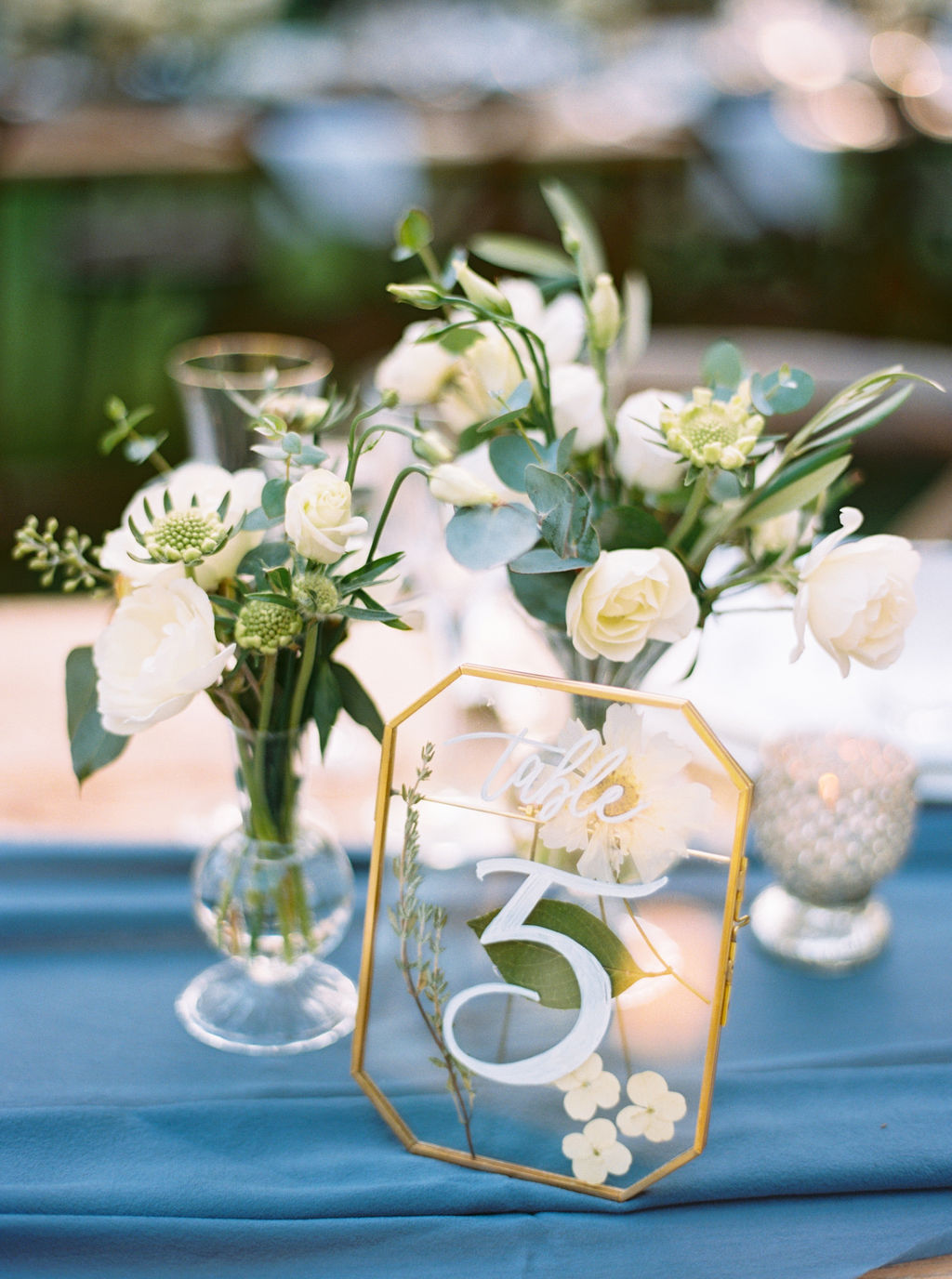 white bud vase centerpiece flowers.JPG
