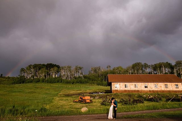Rain on your wedding day isn't always a bad thing!! Look at this rainbow these two got when the rain stopped and the sun came through!!