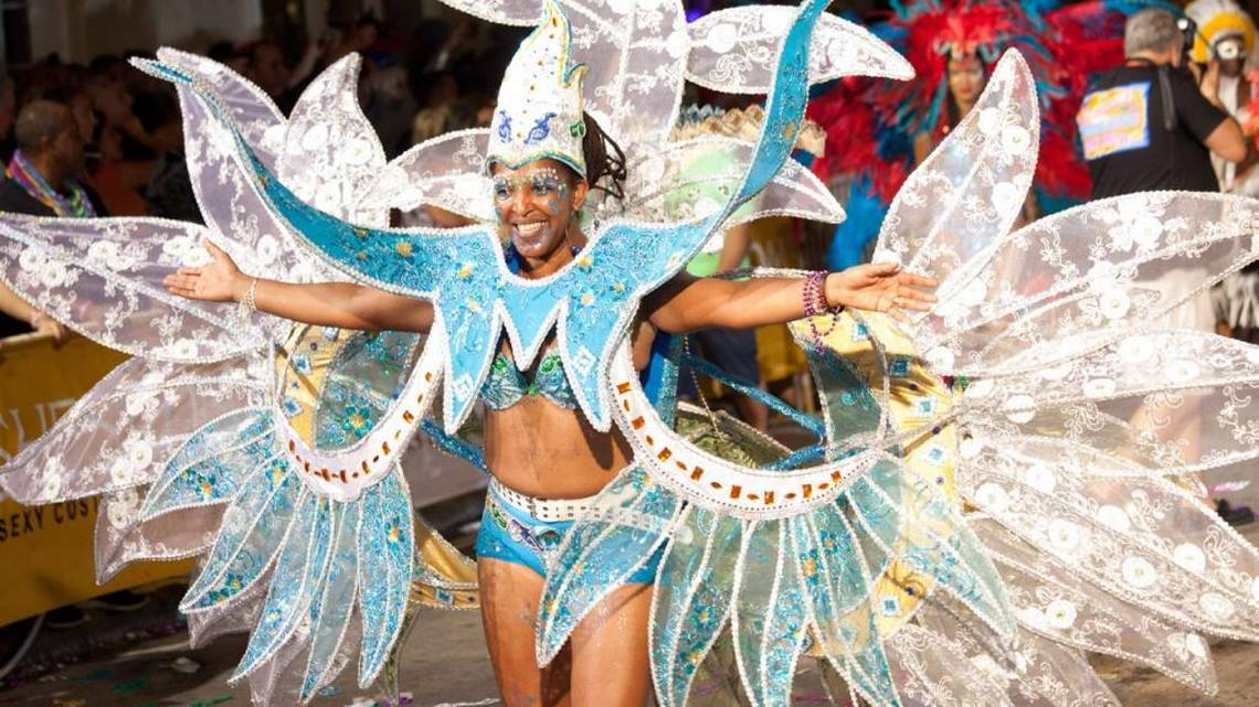 Click to read full article - costumed parade goer
