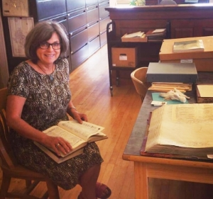 Meg facilitates the drop-in memoir workshops. She is writing a book about her Irish grandmother who immigrated to Butte, Montana. This photo captures her researching for that project in the Butte-Silver Bow Public Archives, Butte Montana
