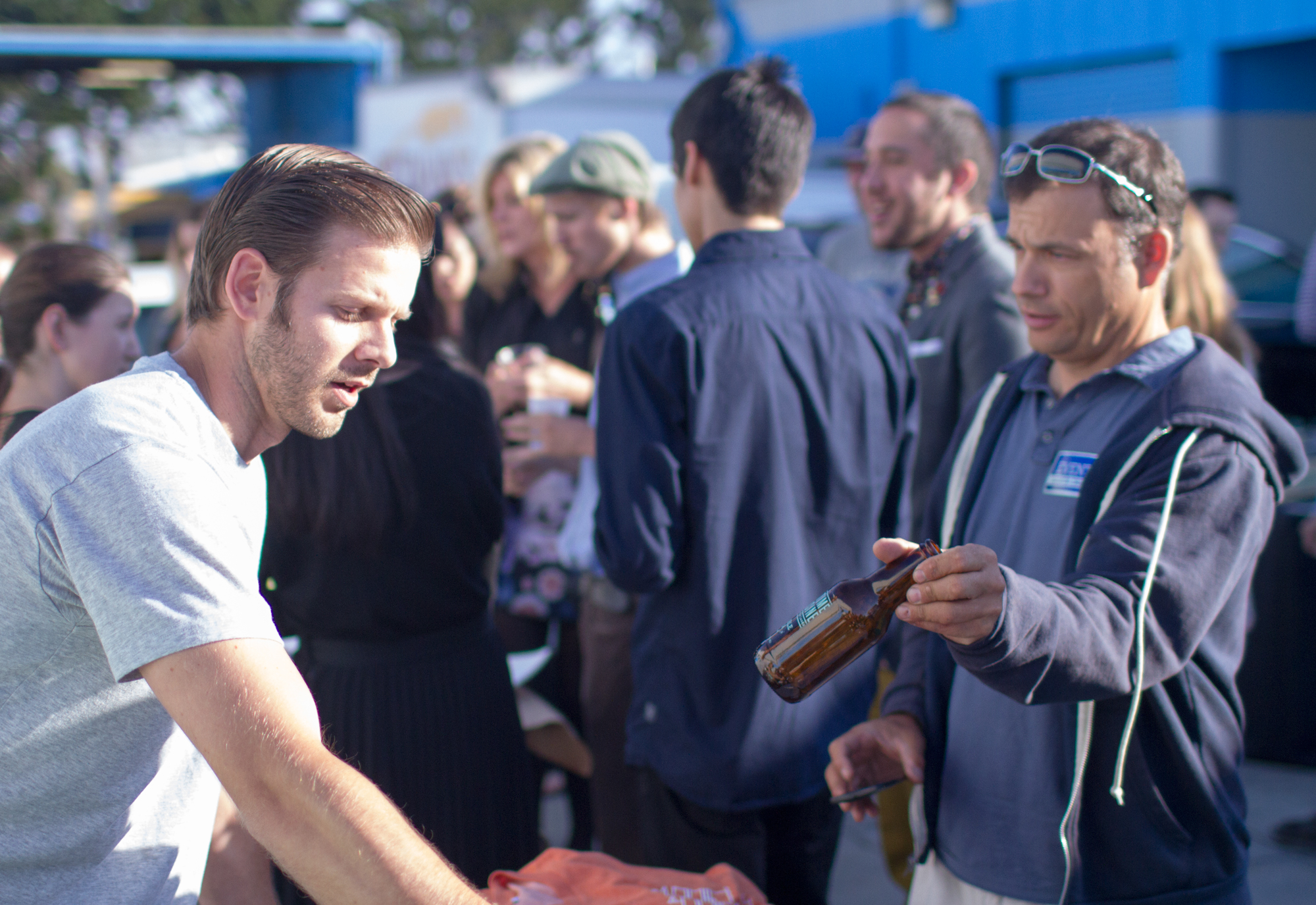 Nick Pavlina serving t-shirts, not beer at the Event Santa Cruz PopUp event last week