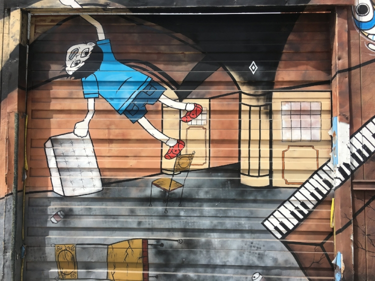 We found this interesting mural on the way. Anyone know a good muralist?