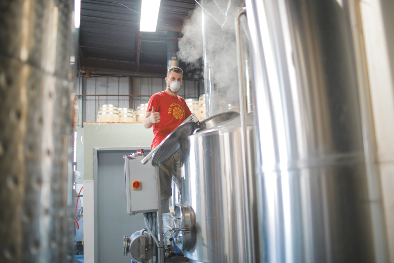 David Nosgrup of Fruition Brewing communicates signs of approval as the beer making gets underway.