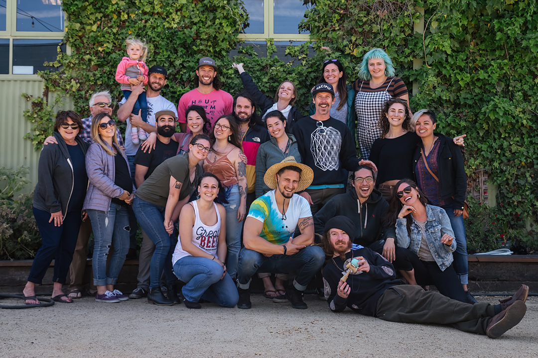 Family photo with employees, patrons, & local businesses. Thanks for the support!