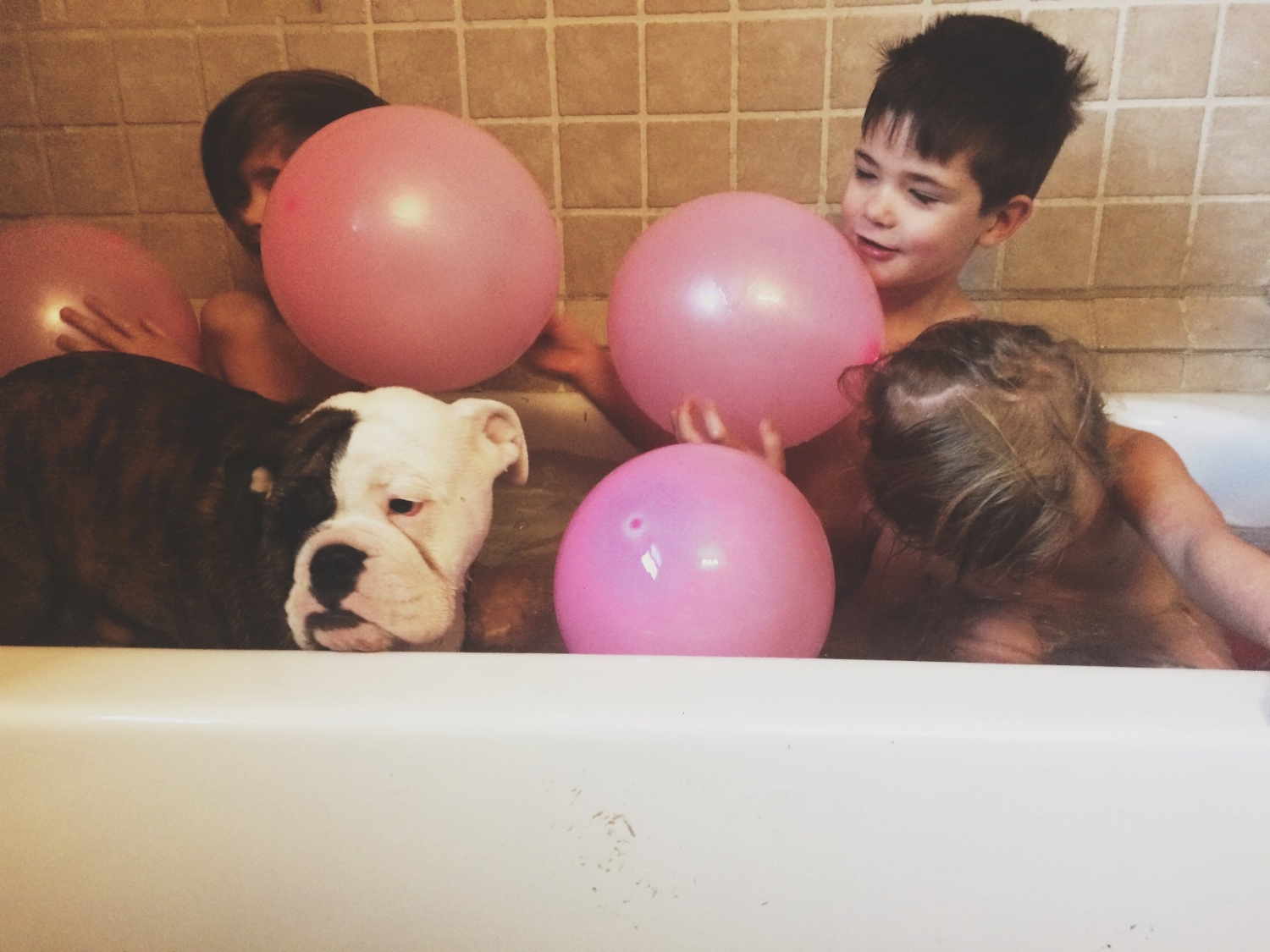 We filled her room with balloons, and what was meant to be a solo bath time quickly turned into a party in the tub. 3 kids, 6 balloons, and a puppy who apparently thought it would be fun to swim.