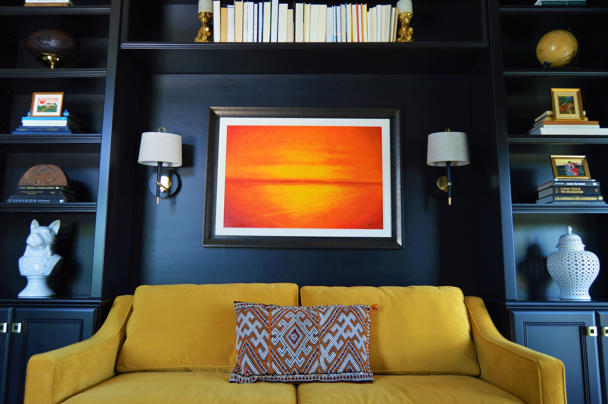 Custom cabinetry designed by Chloe Joelle Beautiful Living. Couch is from West Elm. Jonathan Adler sconces. Original art. Pillow sourced from Marrakech Souk.