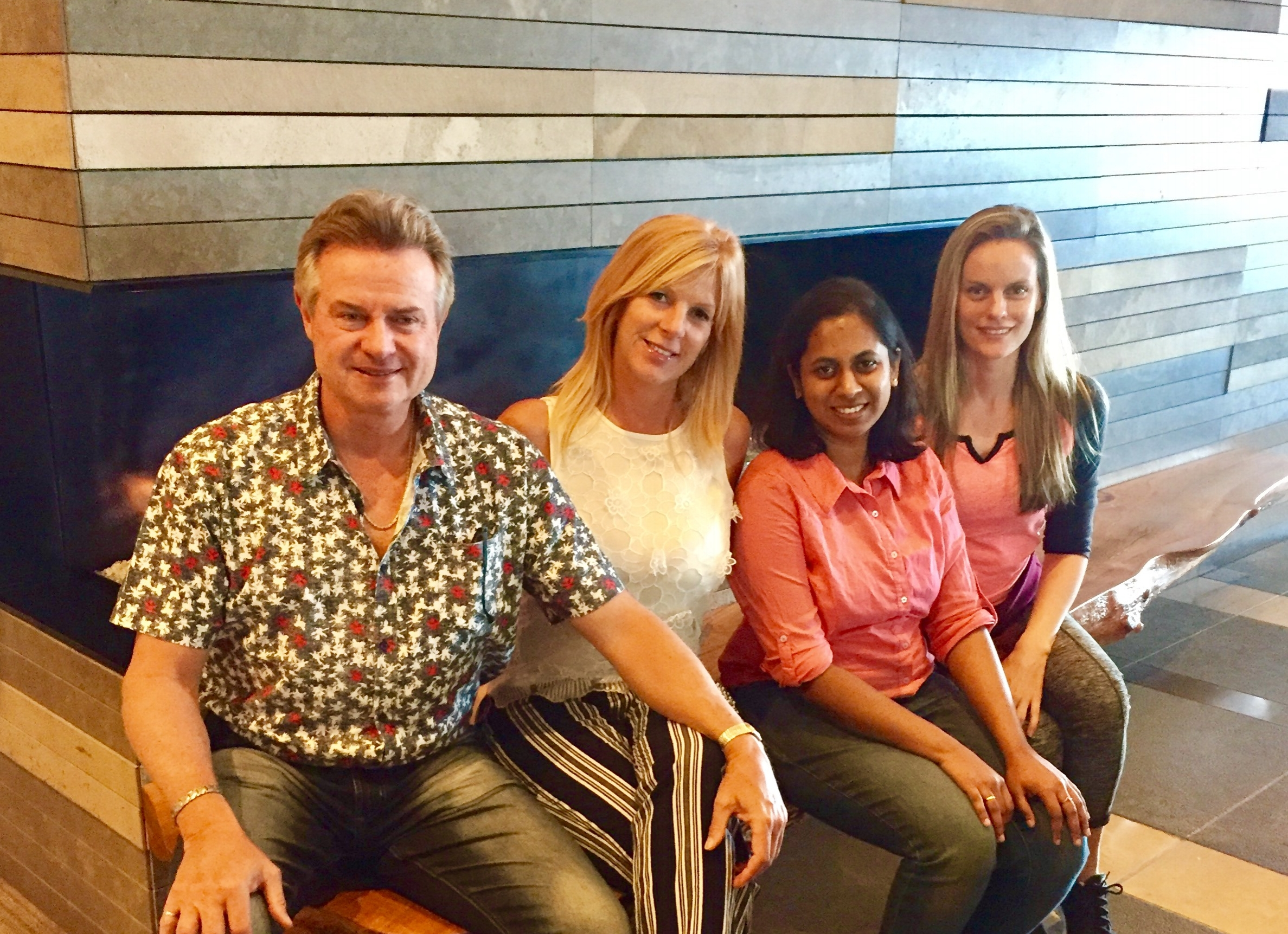 Michael, Stacey, Nithya, and Jennifer gathering at a meeting in downtown Seattle on July 5, 2017.