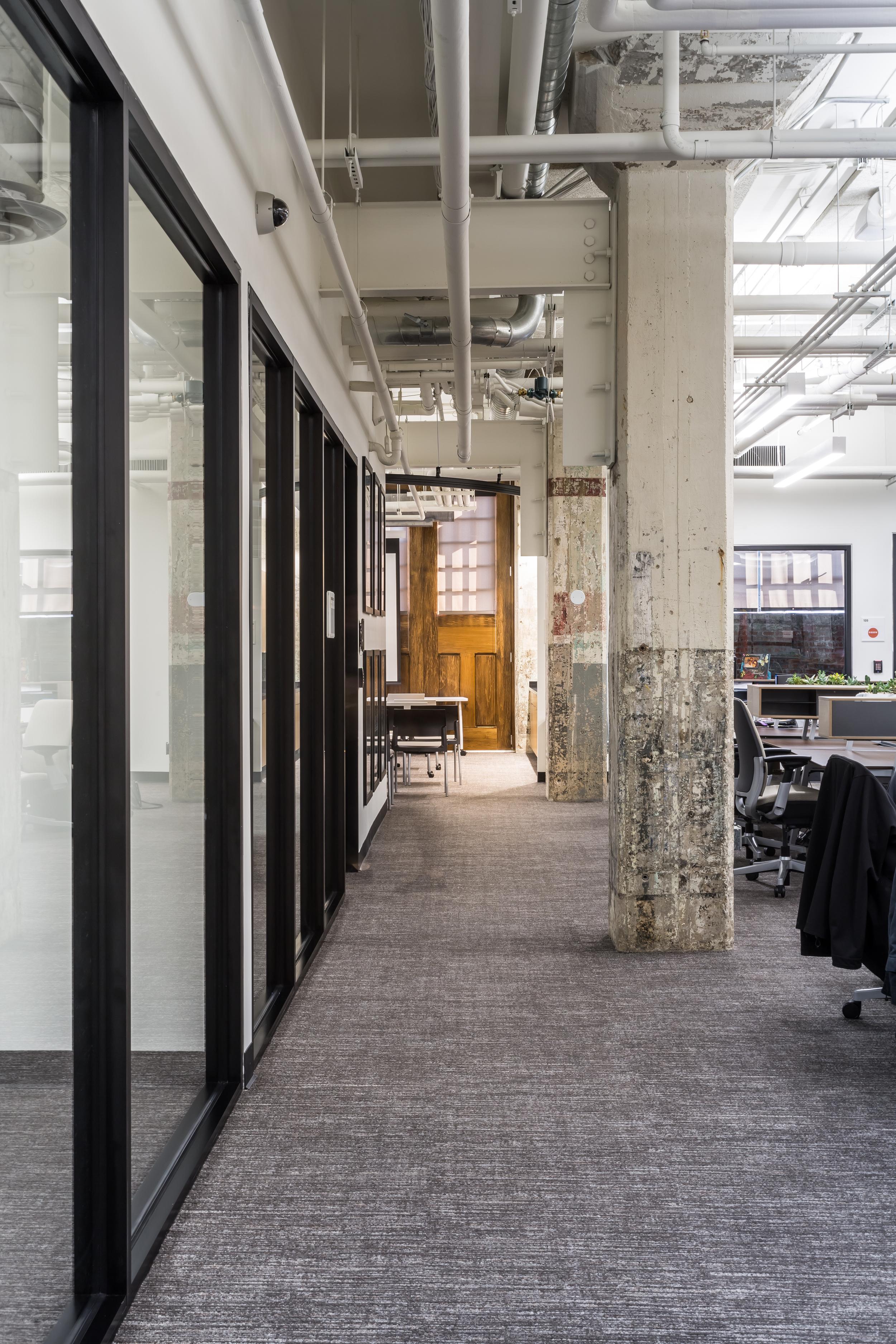 Original concrete pillars in the designated desk area